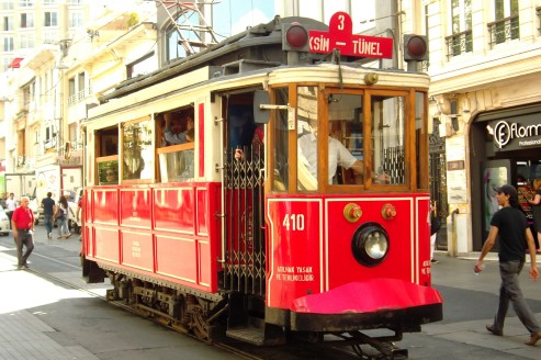 This old tram progresses at snail's pace down Istiklal Caddesi, the bell rung frequently to alert the droves of pedestrians.
