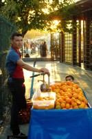A mobile cart from which oranges are sectioned and squeezed for passing foot trade at Eminonu Iskelesi.