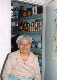 Old Yia-Yia as pictured in the ever-busy kitchen. The pantry behind her was a repository of items dating back several decades!