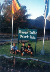 The brothers posing by a sign of the Falls.