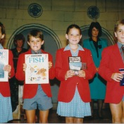 Dan is awarded a book at end of term awards evening (2nd from left), Highlands Junior School.