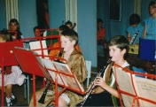 Playing in the school orchestra on clarinet. this was the same evening as a performance of Joseph and his Dreamcoat which explains our dress-code.