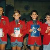 I receive the Tabex Encyclopaedia of Zimbabwe at an end of term awards evening, Highlands Junior. From Right: Ben Murray, Mike Alcock, me, Bronwyn Griffiths.
