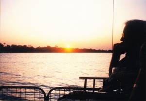 Raph silhouetted against the setting sun, Vic Falls evening cruise.
