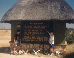 Dan and Ivan in front of a painted information board at Nyamandhlovu Pan.