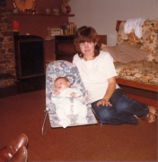 Mum and I in the lounge of our early home.
