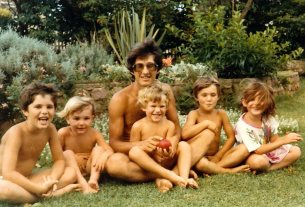 My father with a bevy of kids on the lawn of our grandparent's place in Durban.
