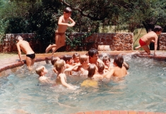 My father in the midst of a crowd of splashing young boys at one of our birthday parties.