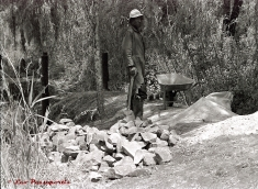 A hired helper, John, who assisted me in the construction of the wooden bridge over the breach.