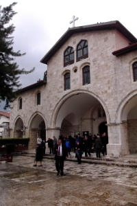 The congregation of the Greek Orthodox church emerge after the service to a wet and rainy morning.