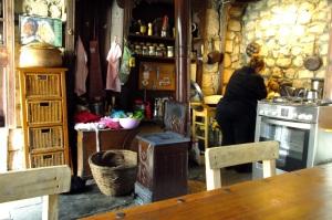 Melek working in Barbara's simple but tidy little kitchen.