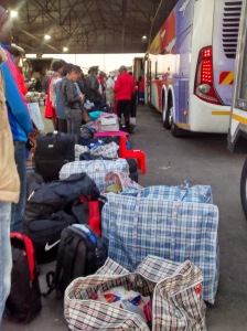 An illustration of one of the delights that awaits the hapless traveller at the border post: queueing outside the bus at dawn with all ones belongings on display.