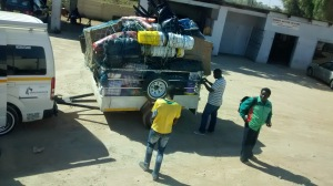 A typical trailer laden high with goods for resale in the Zimbabwe.